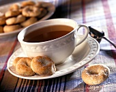 Cup of tea with cakes (small doughnut rings)