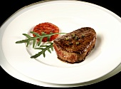 Beef fillet steak with green pepper, rocket and tomato