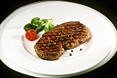 Beef sirloin with green pepper, cherry tomato and corn salad
