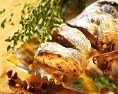 Apple strudel with hazelnuts, raisins and icing sugar