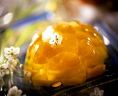 Jelly with mandarin oranges and pineapple; white flowers