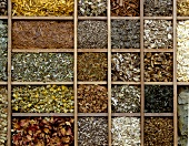 Various dried medicinal herbs in typesetter's case