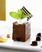 Chocolate terrine with cream and candied cherries