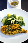 Fried plaice with herbs and green vegetables