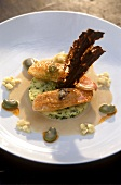 Red mullet on potato cakes in cream sauce