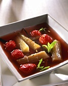 Strawberry and rhubarb soup with mint leaves