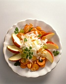 Carrot and radish salad with apple wedges and almonds