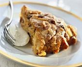 Piece of apple cinnamon cake with icing sugar