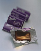 Small chocolate bars (Milka Naps) wrapped & unwrapped