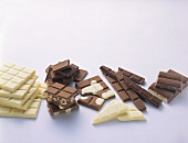 Pieces of white & dark Milka chocolate & nut chocolate