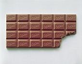 Bar of Milka chocolate, a bite taken