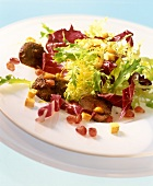 Radicchio with curly endive, poultry liver & pomegranate seeds