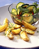 Baked potatoes with courgette salad