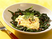 Spinach with egg quark and pink pepper