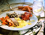 Salmon and crab with carrots, wild rice and lemon sauce