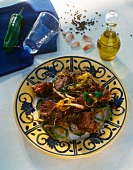 Tunisian grilled lamb cutlets (Mechoui) with onions