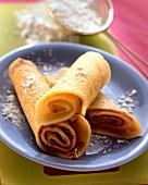 Pancakes with jam and icing sugar