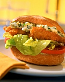 Schnitzel burger with egg sauce and lettuce
