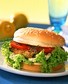 Fish burger with tomatoes and lettuce