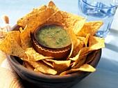 Tomatillo salsa in bowl on tortilla chips