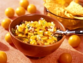 Yellow tomato salsa with onions; tortilla chips