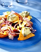 Salad with sweetcorn, avocado dumplings and tortilla chips