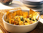 Baked courgettes and sweetcorn with tortilla chips