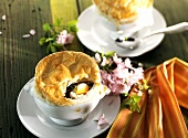 Spring soup under puff pastry crust