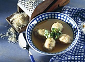 Swiss cheese balls in vegetable bouillon with marjoram