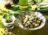 Gnocchi al pesto (potato dumplings with pesto & cheese, Italy)