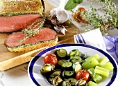 Roast beef with cheese and herb topping and vegetable platter