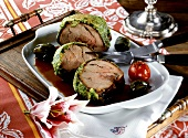 Rolled veal roast with cheese and herb crust (a slice carved)