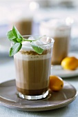 Hot orange- and mint cocoa in glasses