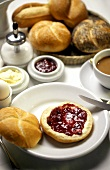 Breakfast with jam roll, egg, coffee and pastries