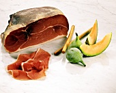 Raw ham with figs, melon and grissini