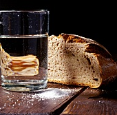 Farmhouse bread, salt and glass of water