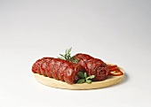Beef roulades on wooden plate