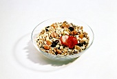 Muesli with dried fruit and fresh strawberry