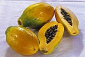 Papayas, one halved