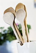 Wooden spoons in white jug