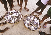 Fresh shellfish for sale in baskets (India)