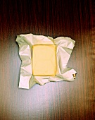 Piece of butter on foil-backed paper