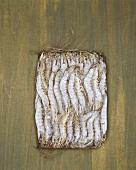Tiger prawns, frozen in a block