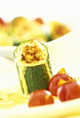 Baked stuffed courgettes with tomatoes