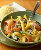 Penne with salmon and spinach in cream sauce
