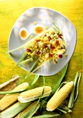 Summery sweetcorn salad with boiled eggs and pineapple
