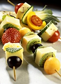 Colourful cheese kebabs with fruit and vegetables