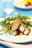 Wild herb salad with chicken breast in zwieback panade