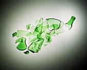 Broken green glass bottle