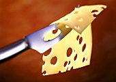 Slice of Emmental cheese on cheese knife